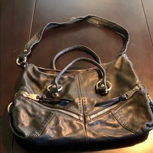 Black leather purse with silver hardware.